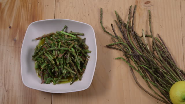 wild asparagus salad top view of a bowl of wild asparagus salad - bowl stock videos & royalty-free footage