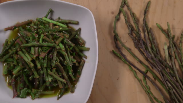wild asparagus salad cu top view of a bowl of wild asparagus salad - bowl stock videos & royalty-free footage