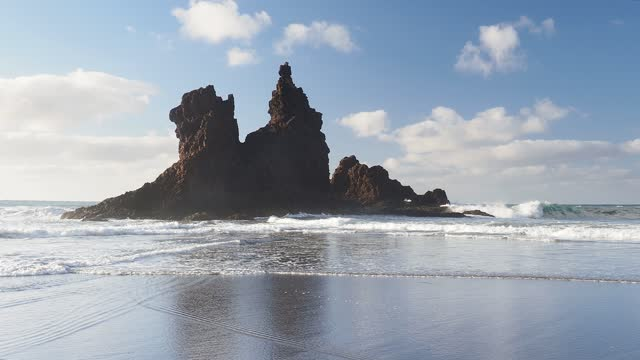 wild beach of volcanic rocks on a windy day and waves at sunset, benijo beach in the canary islands. - atlantik stock-videos und b-roll-filmmaterial