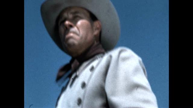 vídeos y material grabado en eventos de stock de wild bill elliott in close up while riding a horse. - western usa