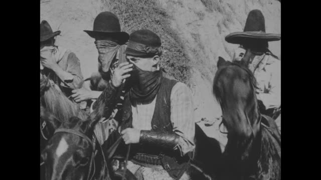 1918 wild bill hiccup and his entourage of four arrive on horseback with plans to raid the saloon - hiccup stock videos and b-roll footage