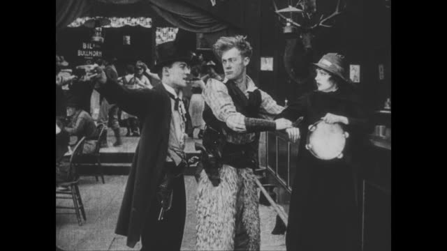 1918 wild bill hiccup pushes man (buster keaton) when he tries to help the salvation army woman - 平手打ち点の映像素材/bロール