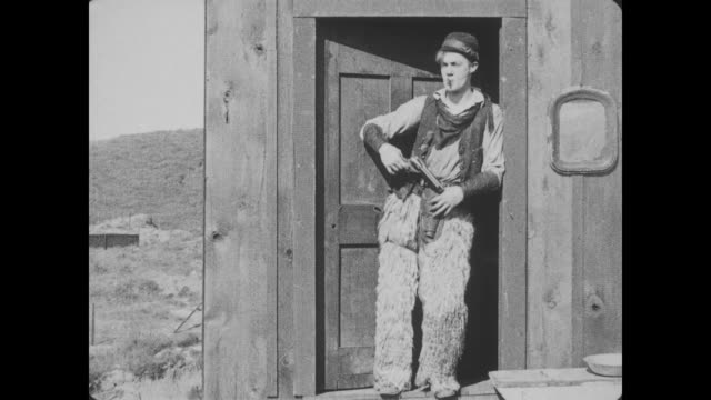 1918 Wild Bill Hiccup shoots a gun and smokes a cigarette