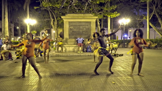 wild dancing young locals in street of Cartagena at night