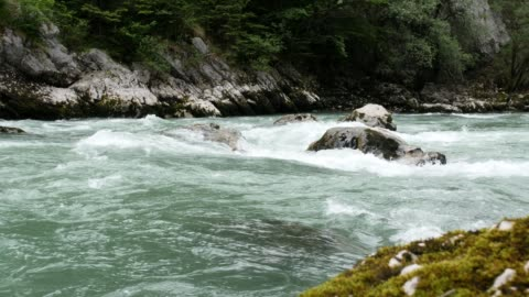 wild mountain river on a cloudy day (wide crane shot) / slow motion - flowing water stock videos & royalty-free footage