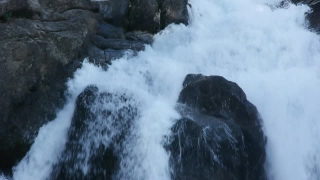 wilderness waterfall cascading over granite boulders, wild & scenic tuolumne river, yosemite national park, california - granite stock videos & royalty-free footage