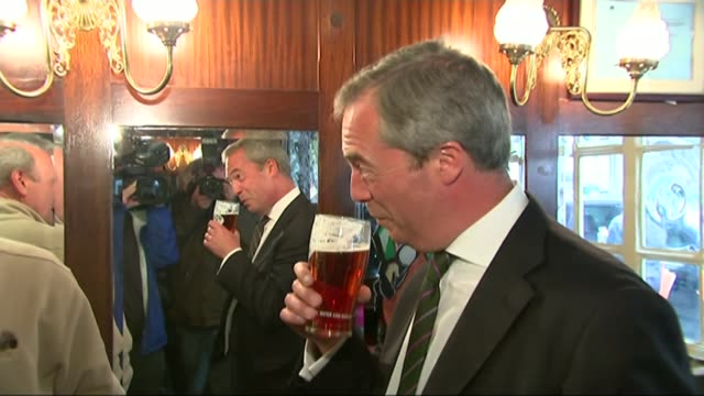 wilders convicted of discrimination / rise of populism r26051412 / 2652014 farage holding pint of beer in pub - populism stock videos and b-roll footage