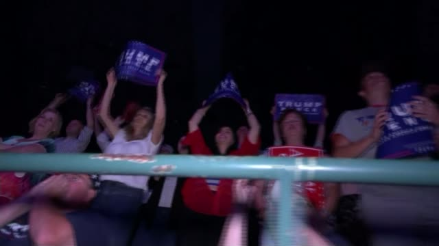 wilders convicted of discrimination / rise of populism t25081637 / 2582016 jackson int crowd at trump rally placard held at trump rally - populism stock videos and b-roll footage