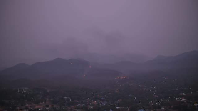 Wildfire on hillside at night