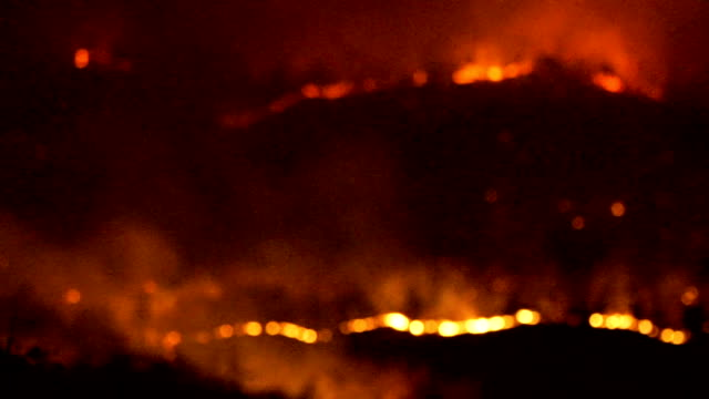 Wildfire Raging in hills at night time