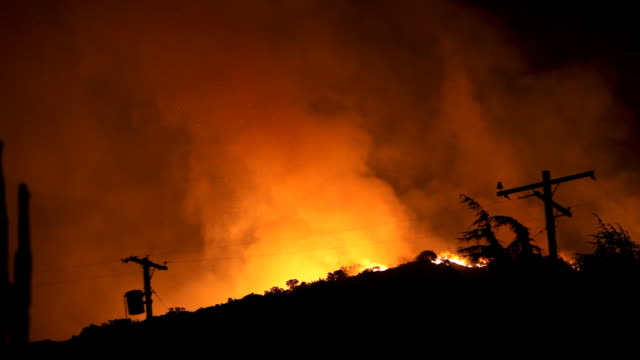 wildfire raging in hills (hd) - power line stock videos & royalty-free footage