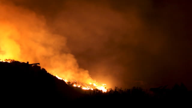 wildfire raging in hills (hd - flammenmeer stock-videos und b-roll-filmmaterial