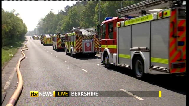 Wildfires across the UK caused by continuing dry weather ENGLAND Berkshire Swinley Forest EXT Reporter to camera PAN to fire engines gathered in road...