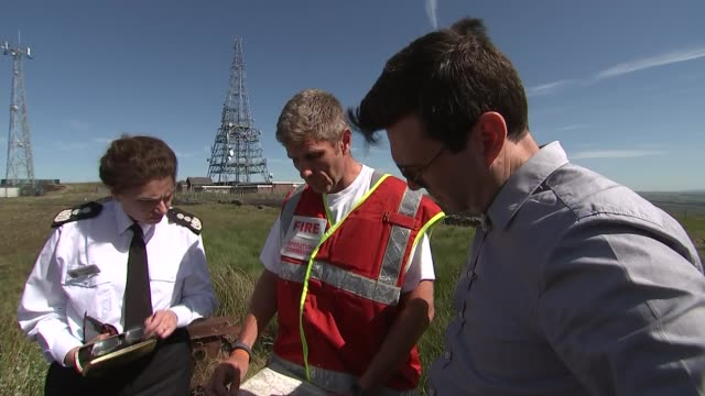 andy burnham vists winter hill england greater manchester near bolton winter hill ext andy burnham chatting to mountain rescue team as smoke blowing... - bolton greater manchester stock videos and b-roll footage