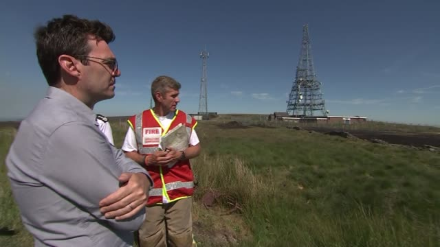 andy burnham vists winter hill england greater manchester near bolton winter hill ext firefighters by fire engine / beating fire / andy burnham along... - bolton greater manchester stock videos and b-roll footage
