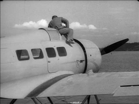 wiley post climbing into hydroplane outdoors / documentary - 1935 stock videos & royalty-free footage