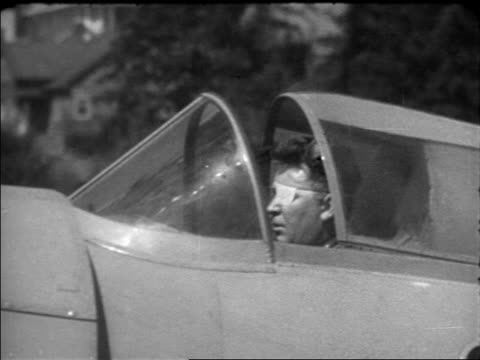 vidéos et rushes de wiley post sitting in cockpit of hydroplane outdoors before fatal flight / documentary - 1935