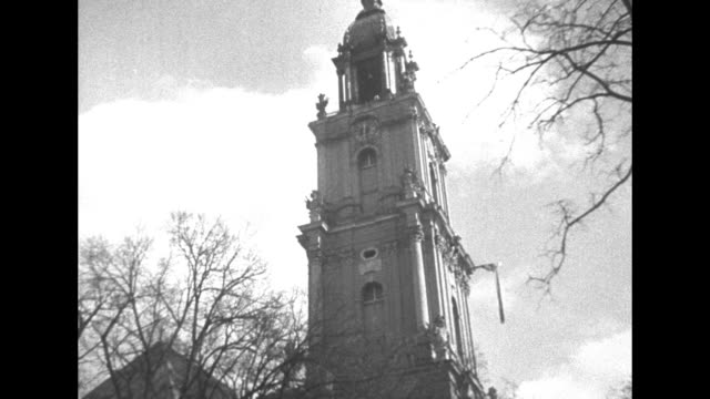 / wilhelm ii standing next to princess hermine talking to her as snow falls / four close shots of bells in church tower / two ground level shots of... - 追放点の映像素材/bロール