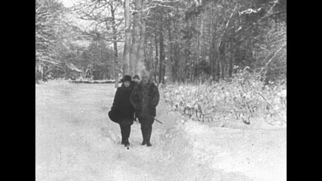 wilhelm, wife princess hermine, her daughter princess henriette, and another young woman walking along path in snow at his huis doorn estate /... - esilio video stock e b–roll