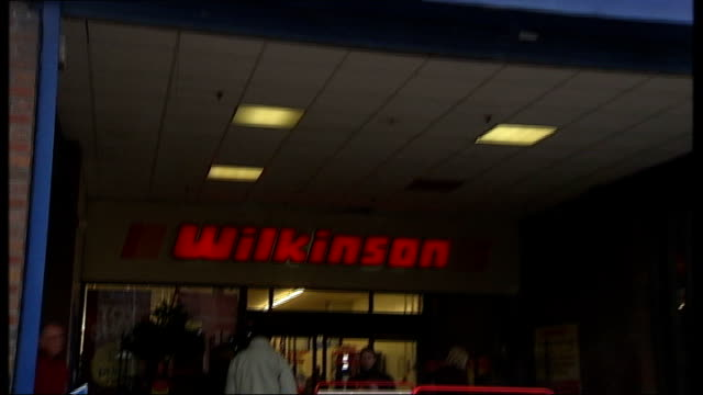wilkinson discount retailer may cut jobs england staffordshire ext shopppers along with bags in front of wilkinson discount retailers store wilkinson... - discount shop stock videos & royalty-free footage