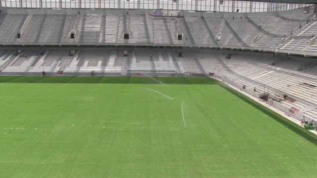 fifa will decide on tuesday whether the curitiba stadium where construction is badly delayed will still be included as a world cup host stadium clean... - südbrasilien stock-videos und b-roll-filmmaterial