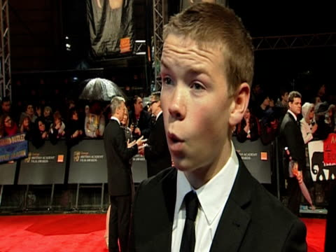 will poulter on the bafta's, the circle choice award nom and more at the orange british academy film awards 2011 at london england. - ブランド名点の映像素材/bロール