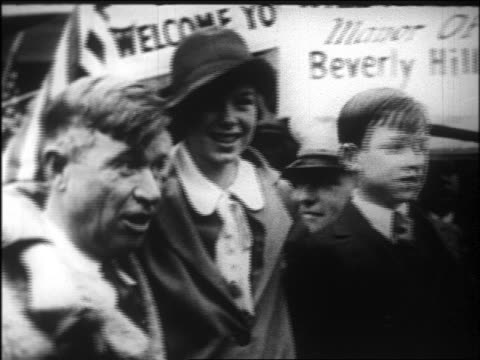 will rogers hugging children after becoming elected beverly hills mayor / newsreel - 1926 stock videos & royalty-free footage