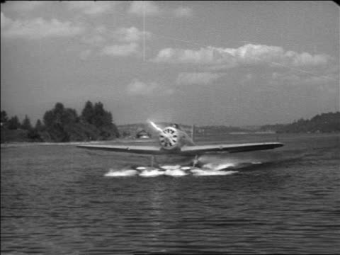 will rogers' hydroplane taxiing on water outdoors / documentary - 1935 stock videos & royalty-free footage
