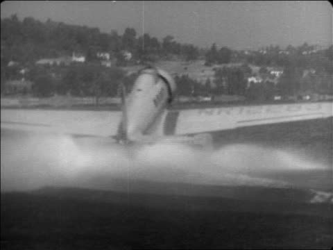 will rogers' hydroplane taxiing on water outdoors / documentary - 1935 stock videos and b-roll footage