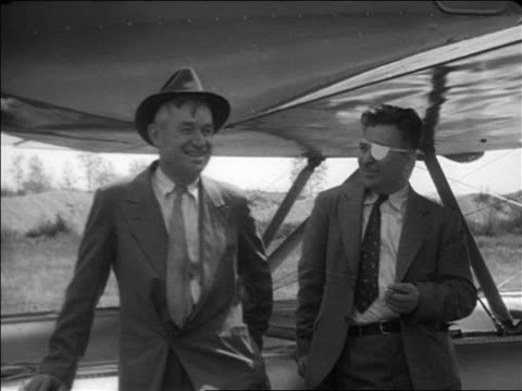will rogers + pilot wiley post standing outdoors laughing / documentary - 1935 stock videos & royalty-free footage