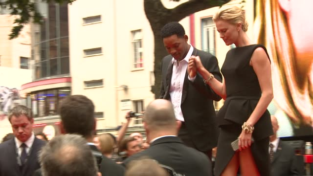 Will Smith and Charllize Theron at the Hancock Premiere at London