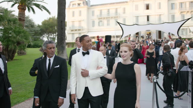 will smith jessica chastain at amfar gala cannes 2017 at hotel du capedenroc on may 25 2017 in cap d'antibes france - international cannes film festival stock videos & royalty-free footage