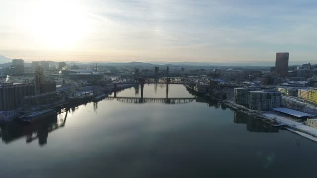 aerial: willamette river in downtown portland at sunrise - portland oregon snow stock videos & royalty-free footage