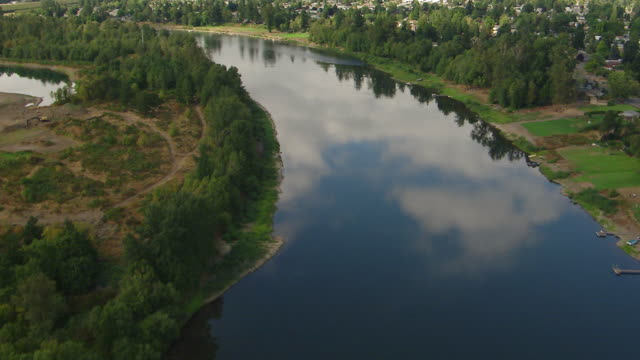 MS AERIAL Willamette River with clouds reflected in water / Oregon, United States