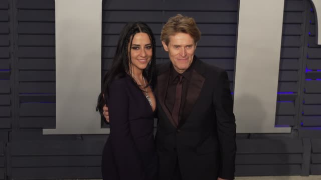 willem dafoe and giada colagrande at 2019 vanity fair oscar party hosted by radhika jones at wallis annenberg center for the performing arts on... - vanity fair oscar party stock videos & royalty-free footage