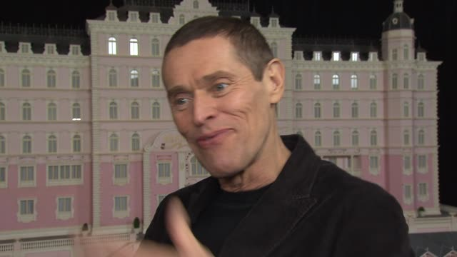 INTERVIEW Willem Dafoe talks about the whole cast living in a hotel together during filming at The Grand Budapest Hotel New York Premiere Presented...