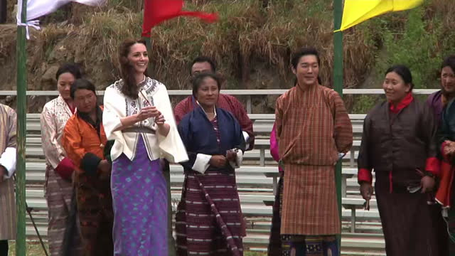william and kate have moved on to the remote himalayan kingdom of bhutan the traditionally dressed duchess of cambridge tried her hand at throwing... - duchess of cambridge stock videos and b-roll footage