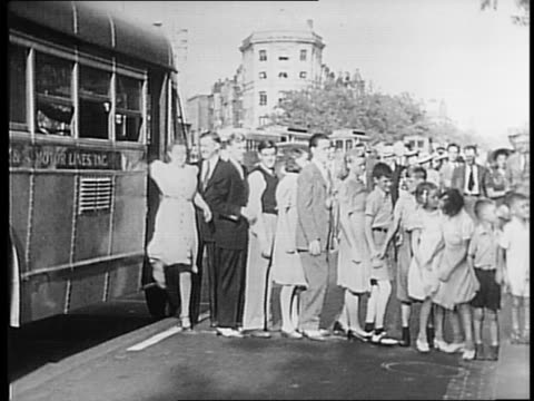 William Andrew White helps family off of bus in Washington DC / Children line up outside of bus / close up of post office sign / Whites walk through...
