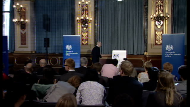 william hague gives first major speech as foreign secretary england london int william hague mp along to podium - john w. snow politician stock videos and b-roll footage