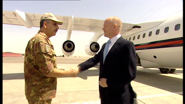 herat air shot plane coming down to land pan as plane lands to bv gv plane taxiing on tarmac william hague mp down plane steps and greeted by italian... - tarmac stock videos & royalty-free footage