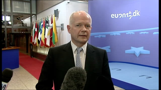 william hague interview on syria belgium brussels int william hague mp into conference venue and interview re syria sanctions sot have agreed... - 制裁点の映像素材/bロール