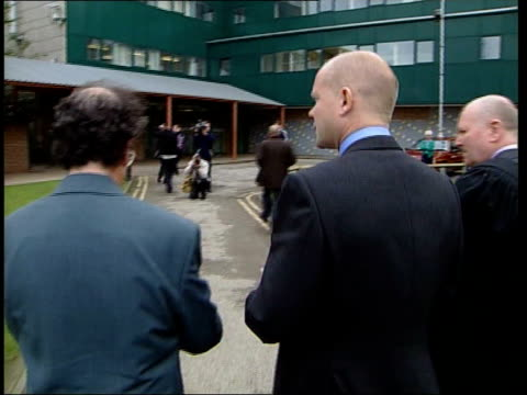 stockvideo's en b-roll-footage met william hague theresa may visit comprehensive school england birmingham great barr comprehensive ext william hague mp theresa may mp out of car... - william hague