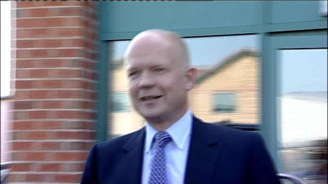 william hague visits his richmond constituency england yorkshire richmond ext car carrying william hague along / william hague mp entering building... - william hague stock-videos und b-roll-filmmaterial