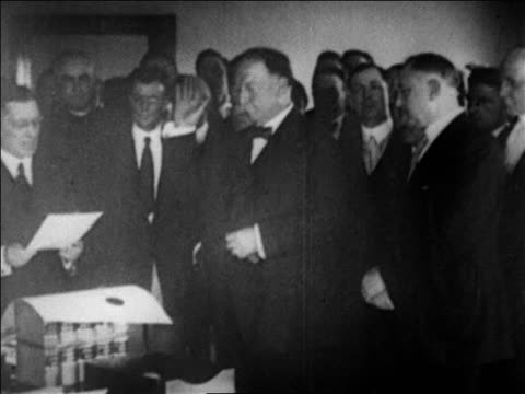 stockvideo's en b-roll-footage met william howard taft swearing in as chief justice of the supreme court / newsreel - 1921