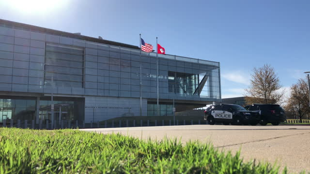 william j. clinton presidential library and museum guarded by two police cars in the morning sunlight. it is temporarily closed due to the... - 映像技法点の映像素材/bロール