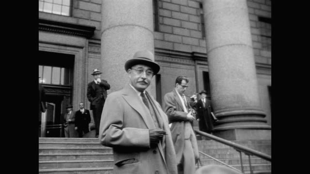 stockvideo's en b-roll-footage met william l patterson national executive secretary of civil rights congress and defense lawyer oetje john rogge on the steps entering the courthouseê - 1940 1949