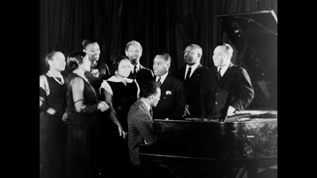 william lawrence african american choir sings around a piano. wpa arts programs employ african americans on january 01, 1937 - wpa stock videos & royalty-free footage