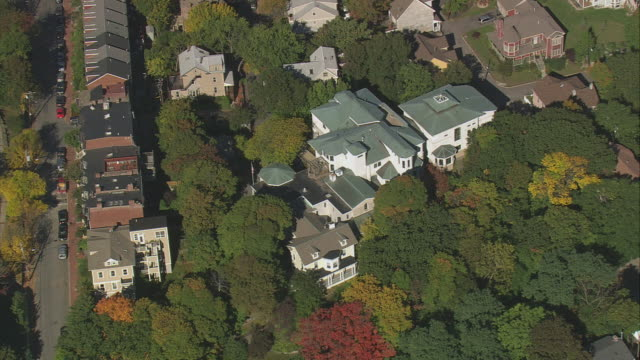 AERIAL William Lloyd Garrison House, surrounding area, and autumn foliage / Boston, Massachusetts, United States