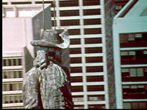 1976 AERIAL CU ZO WS William Penn statue on top of Philadelphia City Hall. Pull back to wide shot down Benjamin Franklin Parkway / Philadelphia, Pennsylvania, USA