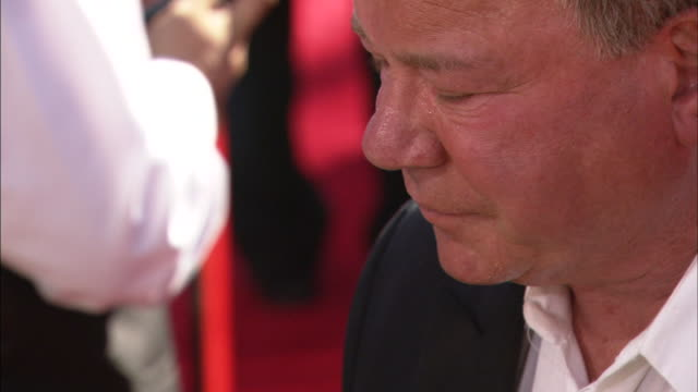 william shatner & elizabeth anderson moving along red carpet talking to reporters - william shatner stock videos & royalty-free footage